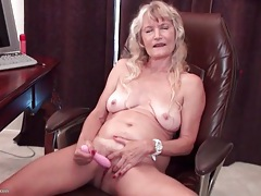 Horny granny masturbates in home office tubes