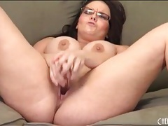 Thick babe in glasses fucks a dildo tubes
