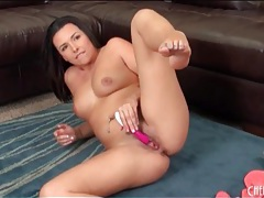 Brunette arouses her pink pussy with a toy tubes