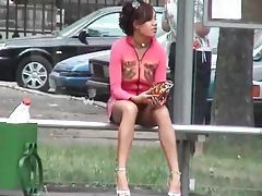 Upskirt on a bus bench with a beauty tubes