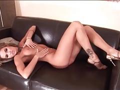 Slim hottie with wavy hair poses in heels tubes