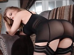 Gorgeous black lingerie on a glamorous blonde tubes