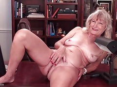 Granny in the office shows off her pussy tubes