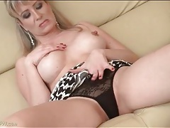 Mommy with marvelous fake tits teases solo tubes