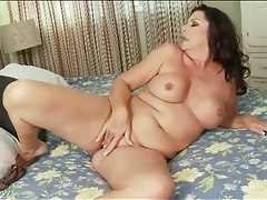 Curvy mature masturbates with her massager tubes