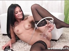 Teen in black stockings toys her young pussy tubes