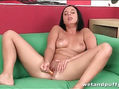 Naked young brunette fucks her box with a toy tubes