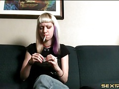 Blonde punk teen lights up a cigarette tubes