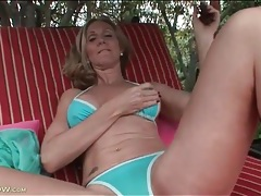 Cute blonde mom in bikini fondles tits outdoors tubes