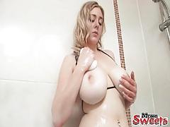 Bikini girl fondles her incredible big breasts tubes