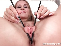 Teen plays with her pussy lips with chopsticks tubes