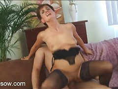 Hot fuck of a slutty mom in black stockings tubes