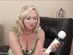 Mature in a pretty sundress masturbates with a toy tubes