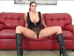 Super voluptuous brunette in boots and lingerie tubes