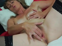 Horny mommy in stockings fingers her twat tubes