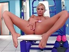 Athletic chick with fake tits masturbates tubes