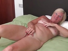 Freckled mature alone in bed and masturbating tubes