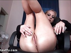 Teen in sexy sweater plays with her cunt tubes