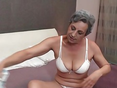 Granny strips to her white panties in bed tubes