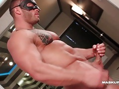 Muscular man cums on his hard abs tubes