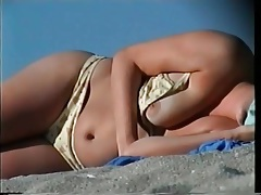 Tits come out of her bikini on the beach tubes