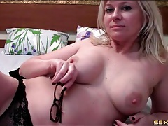 Curvy blonde in glasses in a sexy webcam show tubes