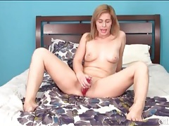 Pink toy turns on a young blonde girl tubes
