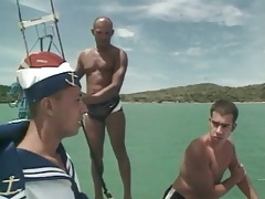Gay cocksucking threesome on a boat tubes