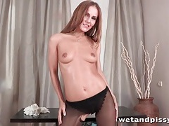Solo urine video with hot girl in black pantyhose tubes