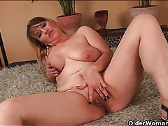 He licks and fists her slippery mature pussy tubes