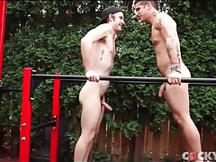 Athletic young guys suck dick outdoors tubes