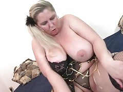 Blonde bbw looks sexy in black fishnets tubes
