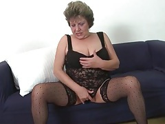 Voluptuous old lady in black lace lingerie tubes