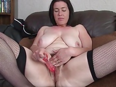Curvy milf with a huge bush toys her vagina tubes