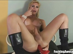 Sexy shemale in black boots toys asshole tubes