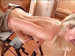 Blonde sucks off shaft through a gloryhole tubes