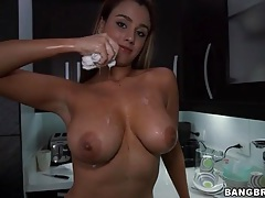 Latina maid soaks her big tits in the kitchen tubes