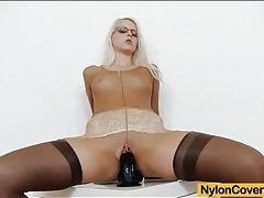 Nylon fetish girl in stockings and pantyhose tubes