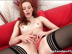 Redhead plays with her bald pussy tubes