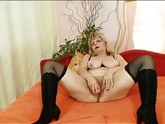 Old lady in sexy high heeled boots shows cunt tubes