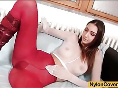 Tall beauty in boots and pantyhose has toy sex tubes