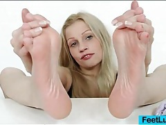 Sexy girl rubs lotion into her gorgeous feet tubes