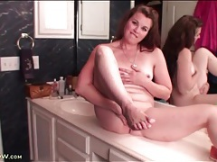 Milf sits on her bathroom counter to masturbate tubes