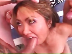 Asian slut sucks and strokes three dicks tubes