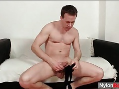 Solo stroking guy puts on black pantyhose tubes