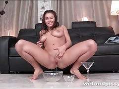 Full bladder girl pees and rubs it on her body tubes