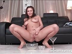 Full bladder girl pees and rubs it on her body tubes