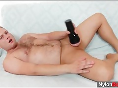 Hairy guy puts on pantyhose to jerk off tubes