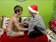 Boys in christmas hats kiss sensually tubes
