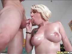 Babe with big oiled up tits swallows a cock tubes